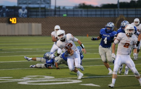Quarterback Jack Swensen runs from Georgetown linebackers for a seven yard gain.