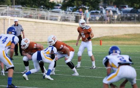 Quarterback Ian Lee '16 prepares to take a snap.