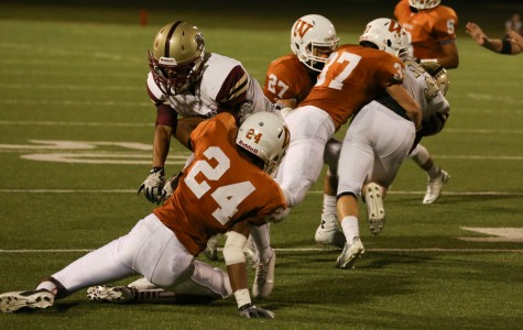 Harley Busfield '16 and Zach Sigler '15 tackle a Rouse receiver.