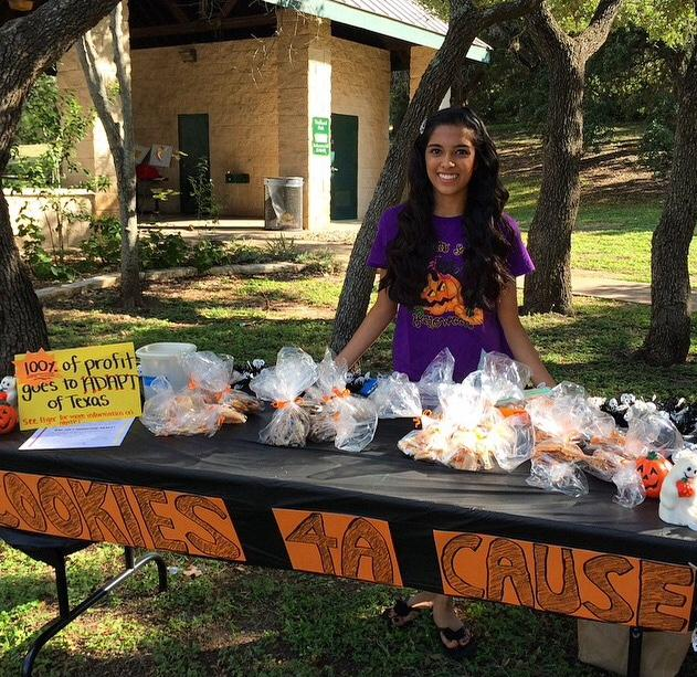 Patel attends the 2014 Fall Fest in Canyon Creek to sell cookies. She donated about $100							to ADAPT.
