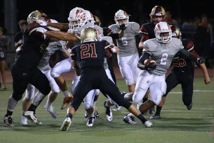 McGinnis '17 makes his way around Rouse defenders for a 40-yard run.
