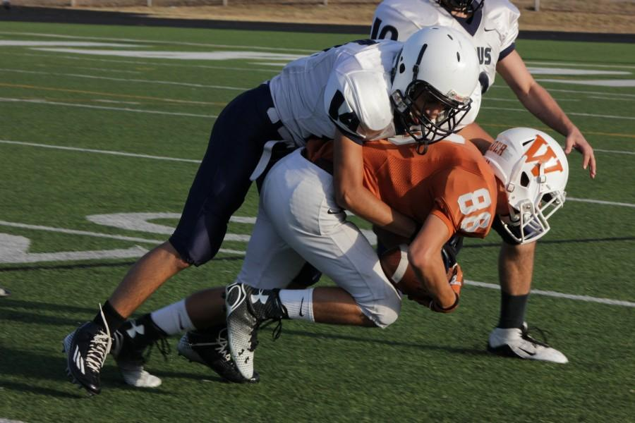 Glen Holder '17 gets tackled.