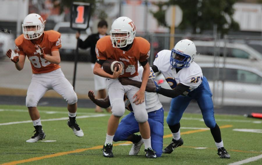 Jack Hiner '18 keeps fro getting tackled.