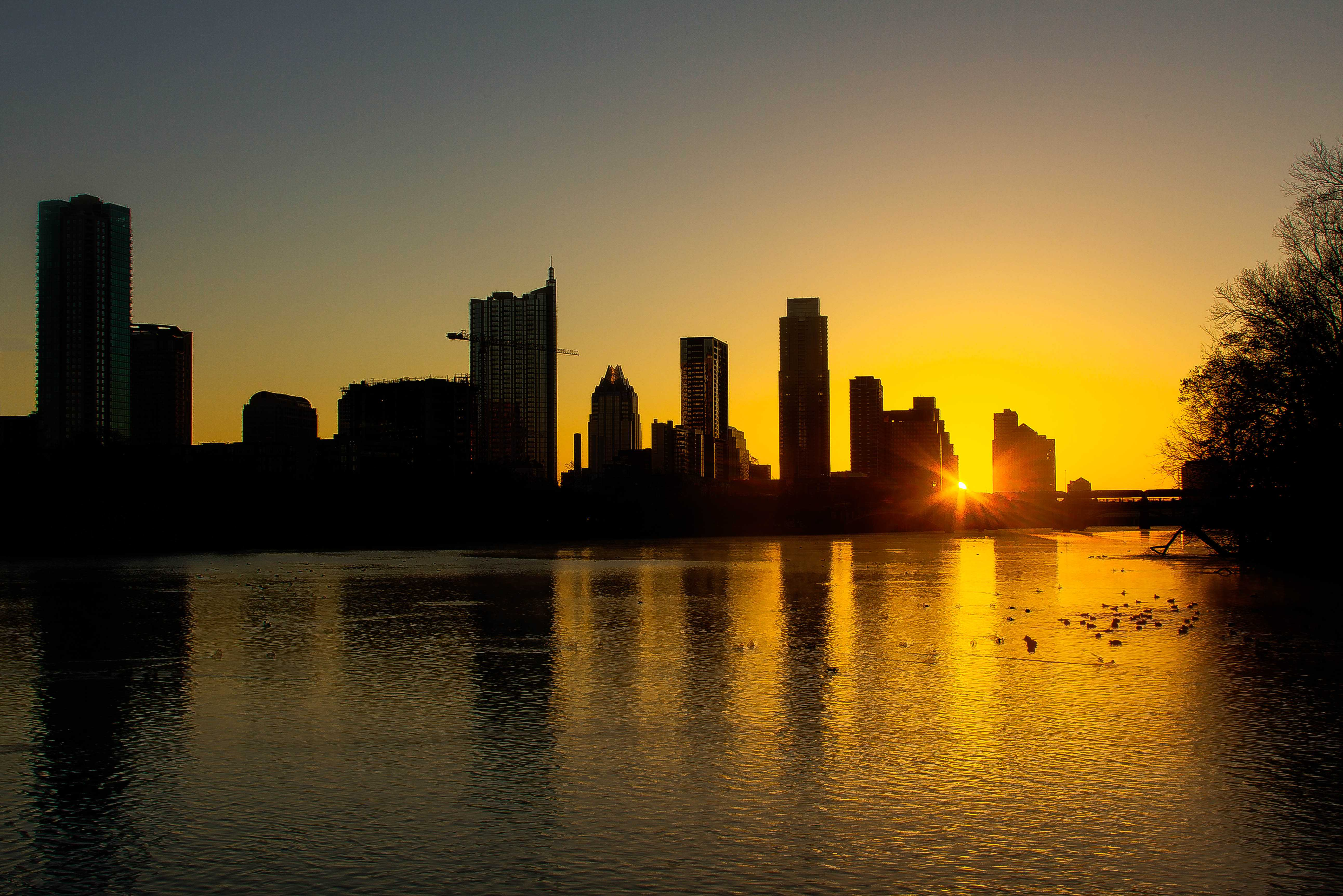 The sun rising over the Wells Fargo building in Austin, TX in February 2013