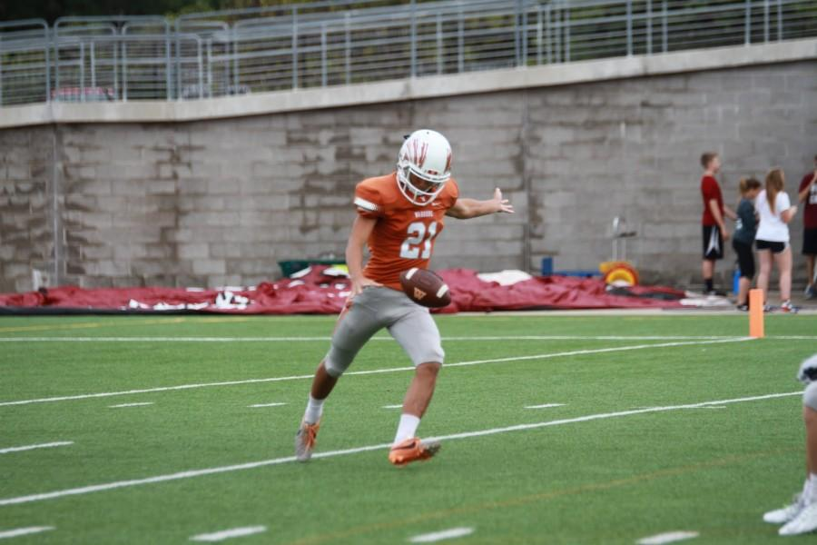 Max Zhao '16 sets up for a punt.
