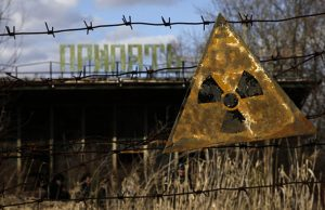 A barbed wire fence guards Chernobyl from visitors.