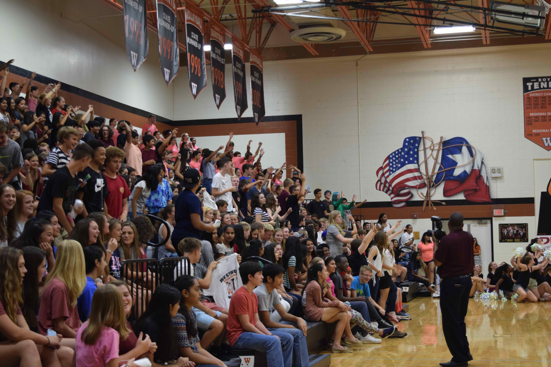 Students cheer during the pep rally at Fish Bowl.