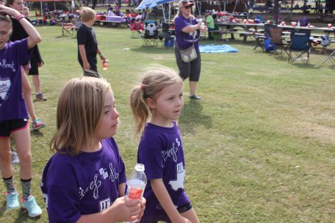 Two girls, one with Down syndrome, walk along side one another during the Buddy Walk.