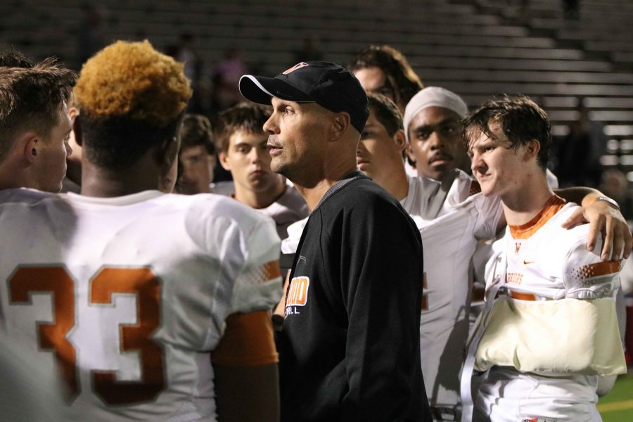 Coach Anthony Wood talks with players after the game.