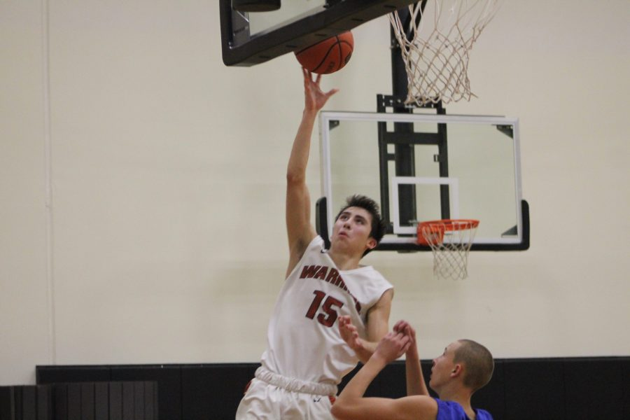 Jumping up for a shot, Santi Campos '20 sinks one in.