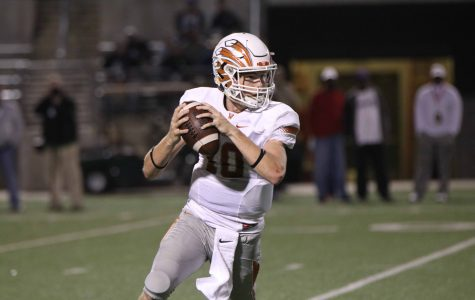 Quarterback Will Jennings '18 looks for an open receiver to pass to.