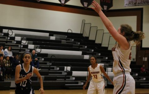 Taking a shot, Madison Couch '17 attempts to score points for the Lady Warriors.