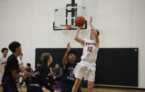 Freshman Orange Boys' Basketball Prevails Over Cedar Ridge 60-32