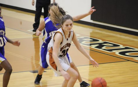 Riley Hammock '20 attempts to keep the ball and score points for her team.