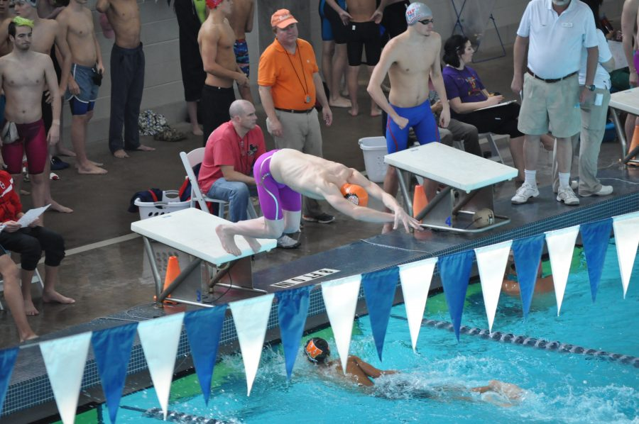 Rory Gatson '18 dives in after a relay member finishes. Photo courtesy of Westwood Swim.