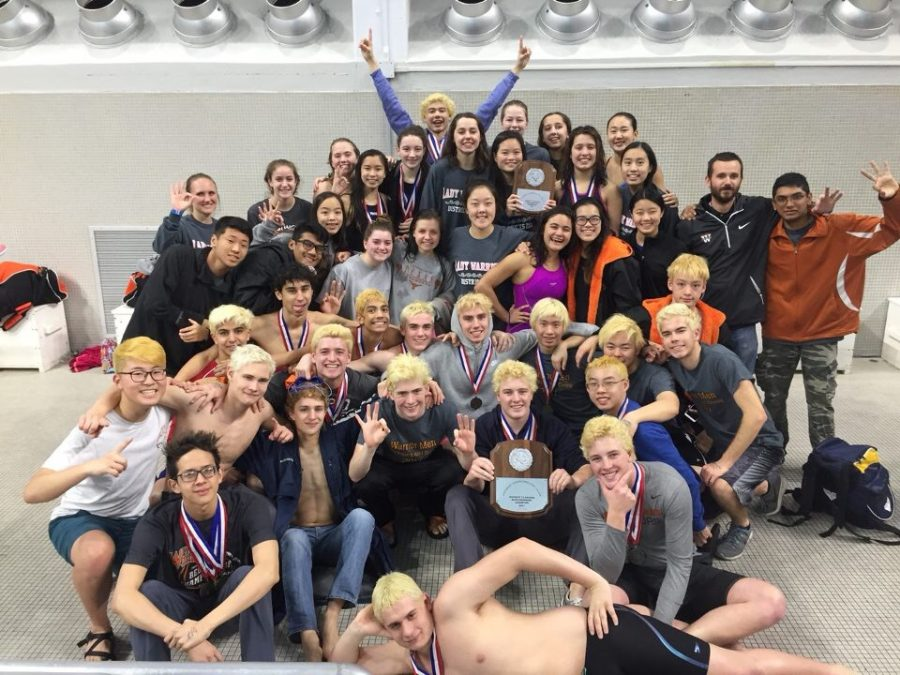 The swimmers pose with their plaques after a successful district meet. Photo courtesy of Westwood Swim and Dive.