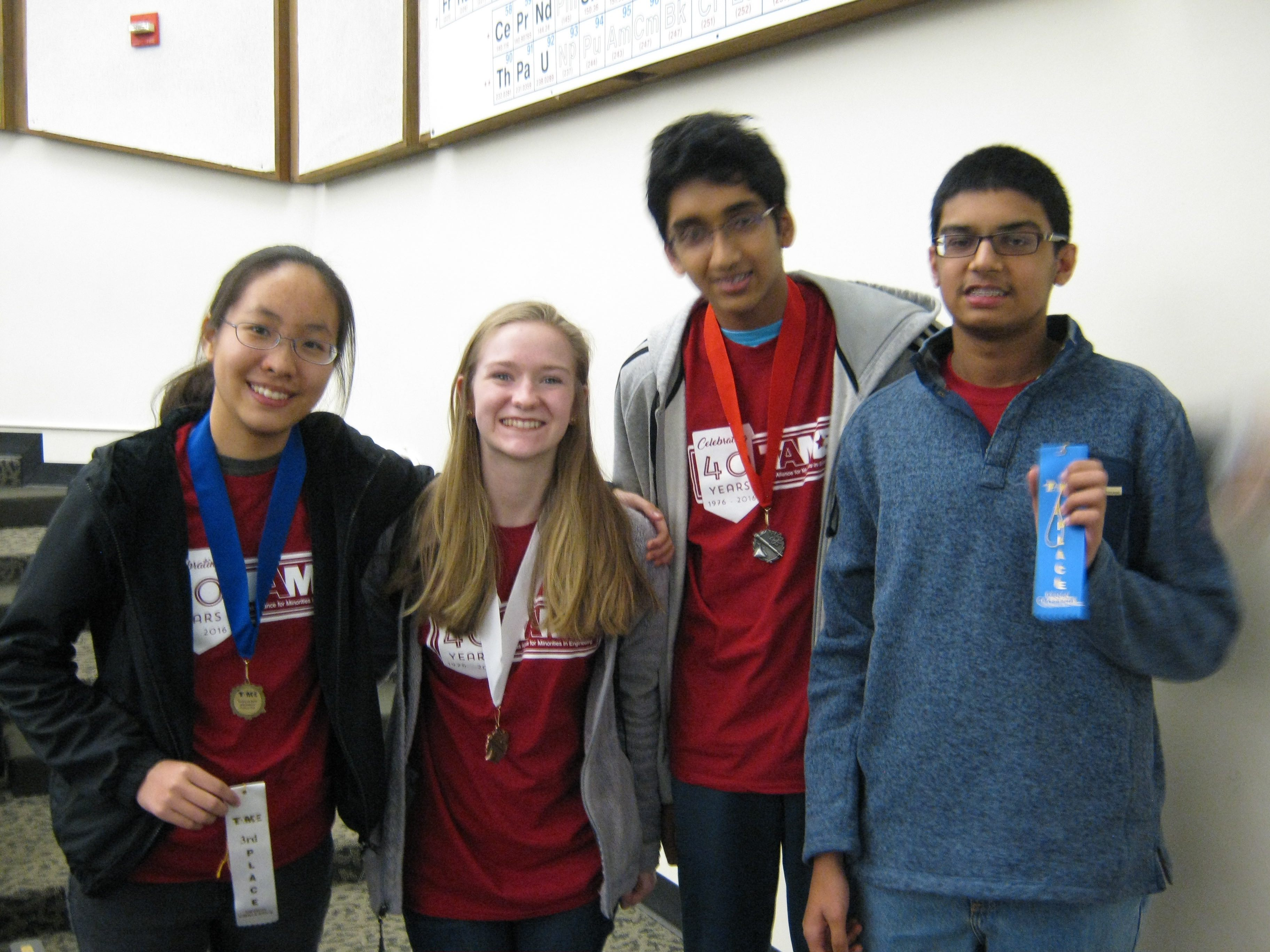 Jenny Zhang '19, Claire Mathieu '18, Himanshu Reddy '20, and Samit Deshmukh '20 stand together and proudly display their winnings   Photo Courtesy of Doug Landers