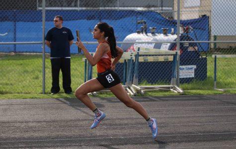 Anchor Purvi Mujumdar '19 runs her leg of the JV girls' 4x100 relay.