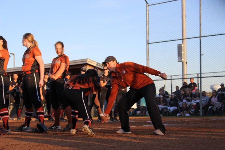 Coach Tiffany Gates high fives center fielder Haily Lozano '19. Photo courtesy of Alex Reece.
