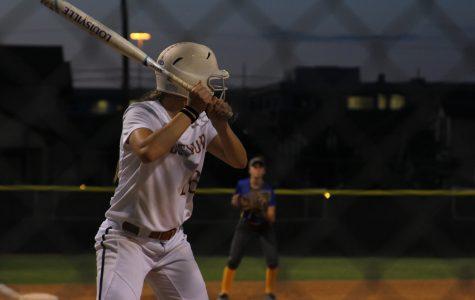 Haley Popelka '18  prepares to strike the ball.