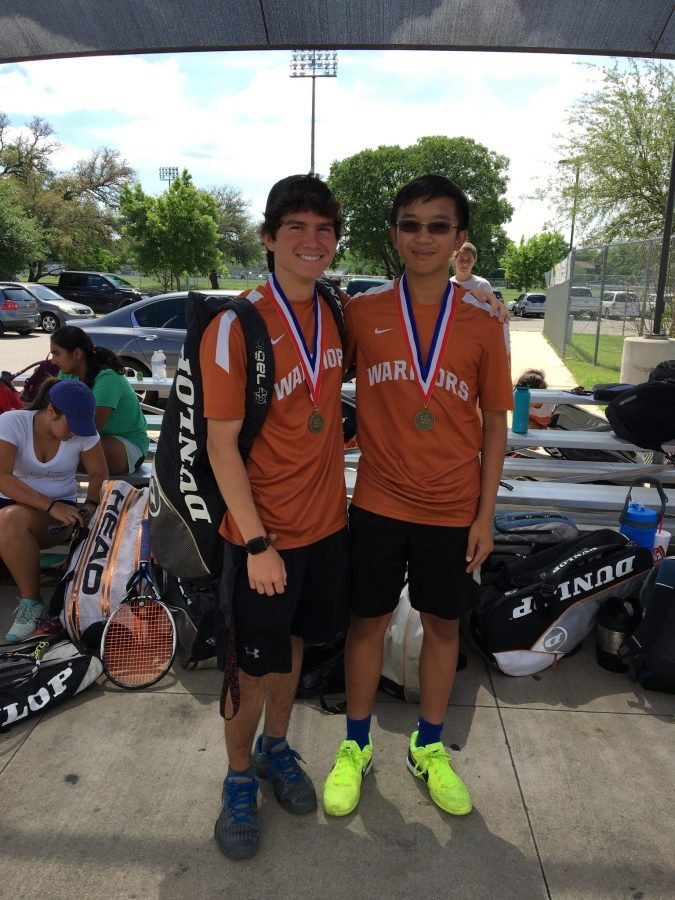 Truman Le '19 and Jake Imperial '19 post with their first place medals after winning the boys' doubles division.