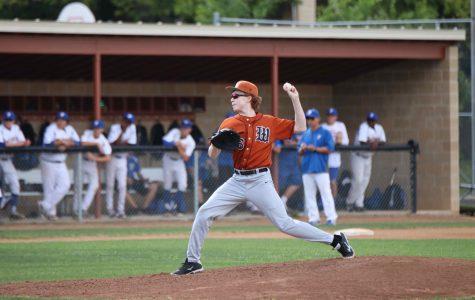 Kolten Smith '19 pitches the ball.