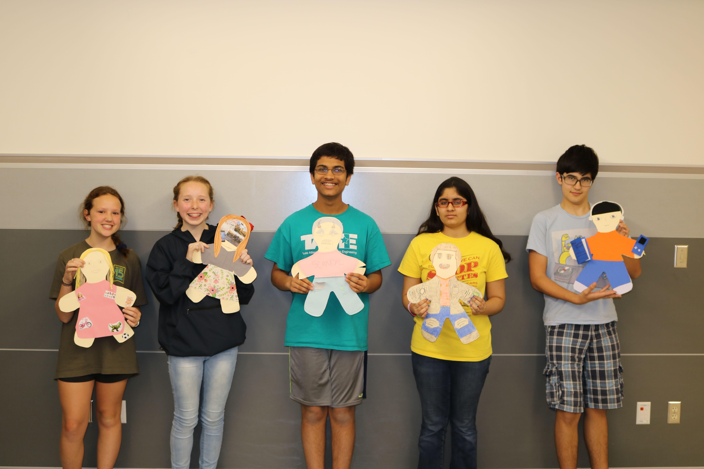 Pre-AP+Spanish+2+students+present+their+dolls.