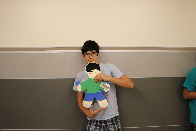 Nicolas+Gonzalez+%2719+presents+his+doll.