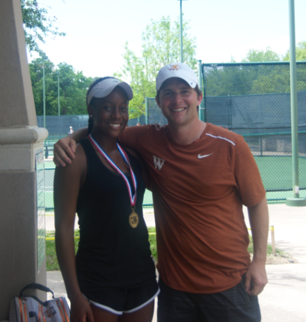 Kiana Graham '20 poses with head tennis coach Travis Dalrymple following her regionals win. Photo credit to Westwood Tennis