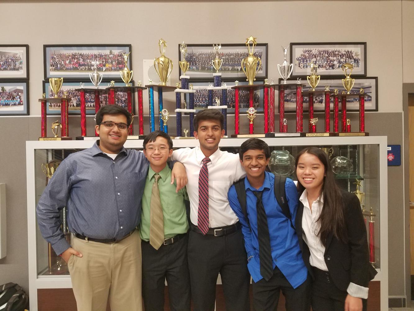 Jugal Amodwala '18, Truman Le '19, Rohith Mandavilli '19, Dhruva Mambapoor '18, and Davina Le '20 pose for a picture. Photo courtesy of WHS Debate.
