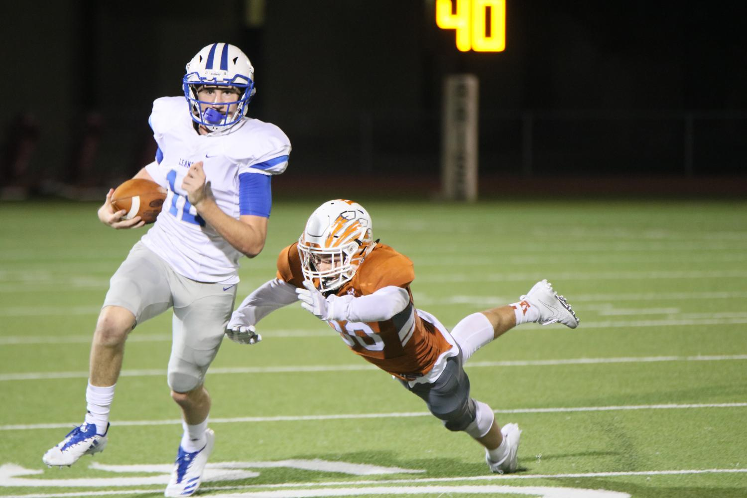 Ethan Brown '19 leaps to tackle a Leander defender.