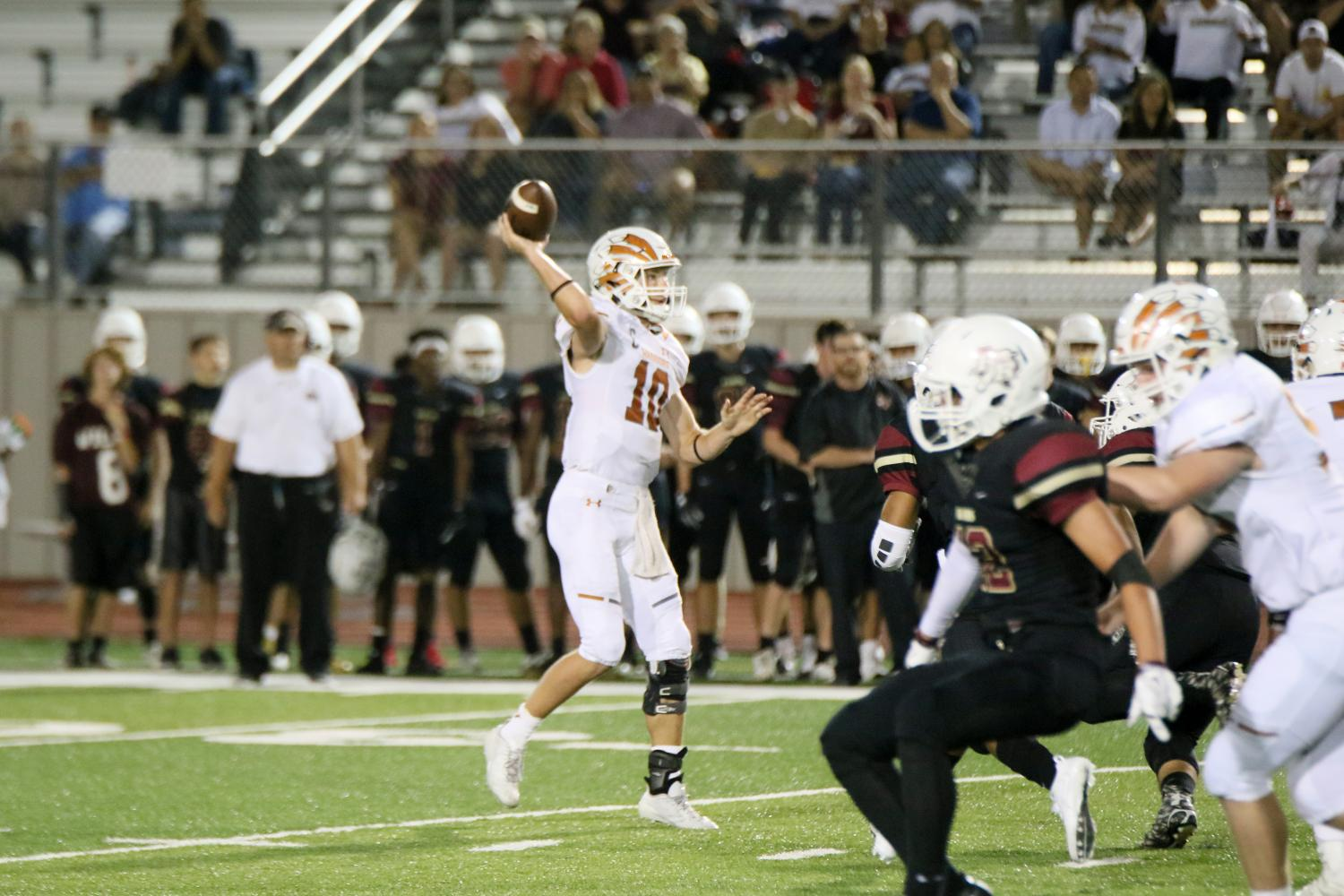 Quarterback Will Jennings '18 throws the ball to an open receiver.
