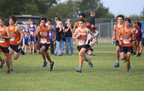 The cross country team begins the race.