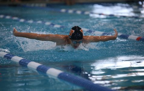 Nathan Early '20 takes a breath during the butterfly portion of the 200 individual medley.