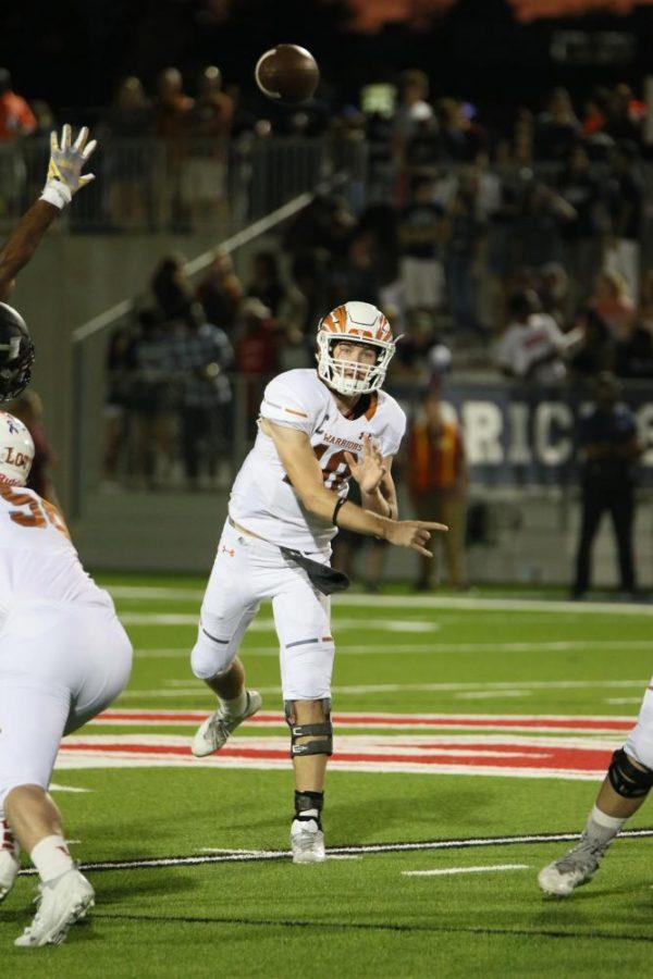 Quarterback Will Jennings '18 throws the ball to Cameron Thomas '18.