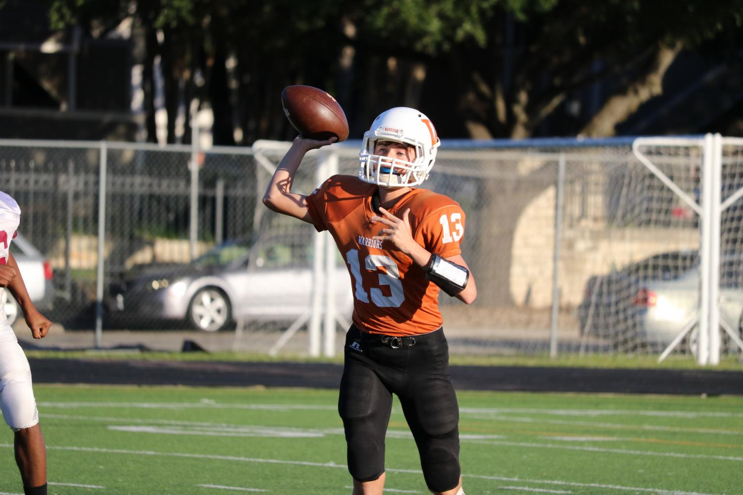 Reece+Frank+%2721%2C+throws+the+ball+to+a+wide+receiver.+