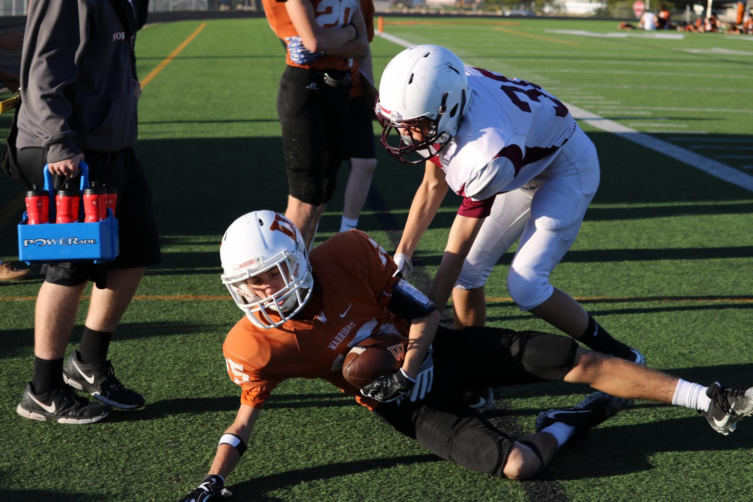 Thomas+Klein+%2721+catches+a+pass+gaining+yardage%2C+but+is+tackled+by+a+defensive+player.+