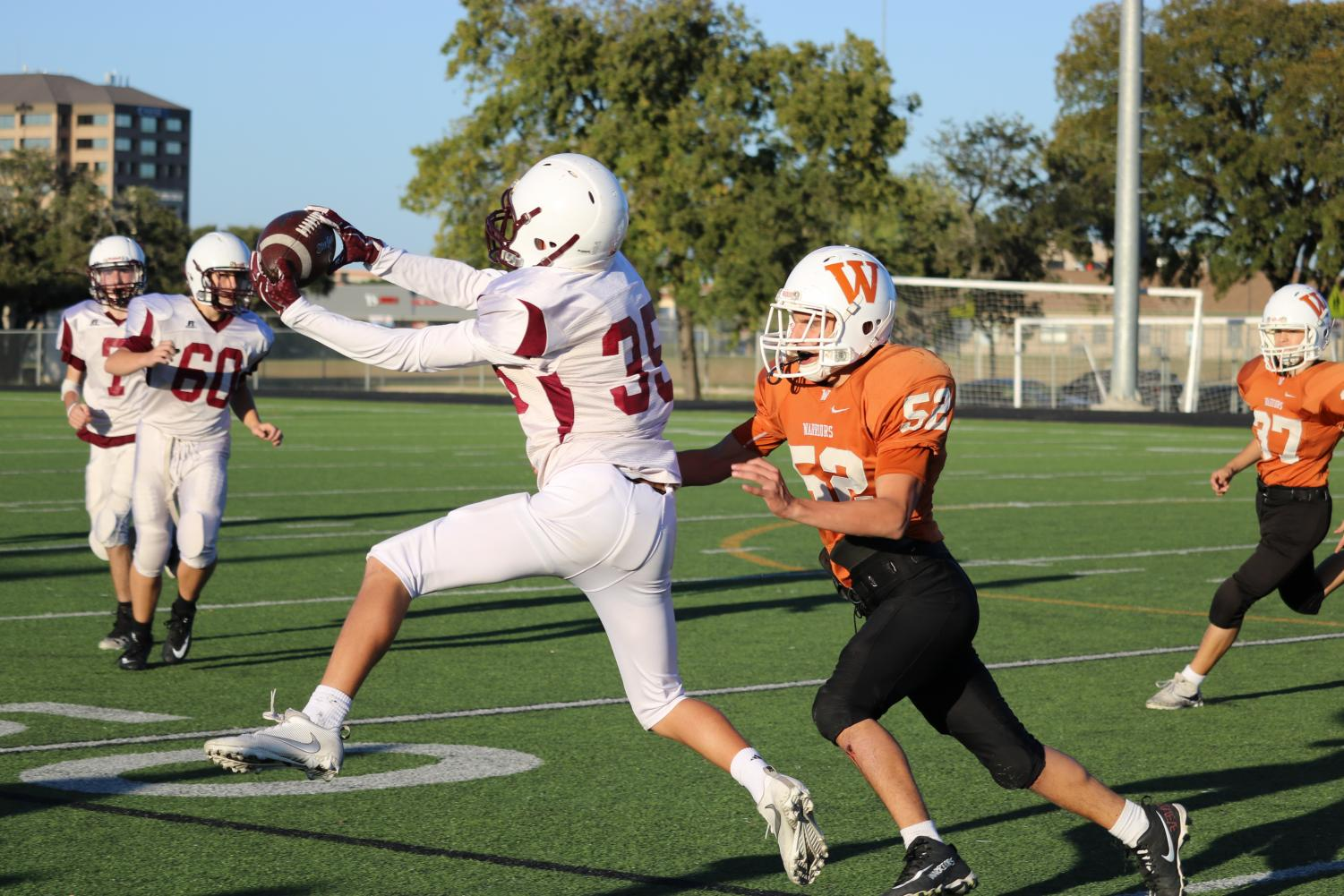 Julian+Garcia+%2721+takes+down+one+of+the+Dragons%27+wide+receivers+moments+after+they+catch+the+ball.+