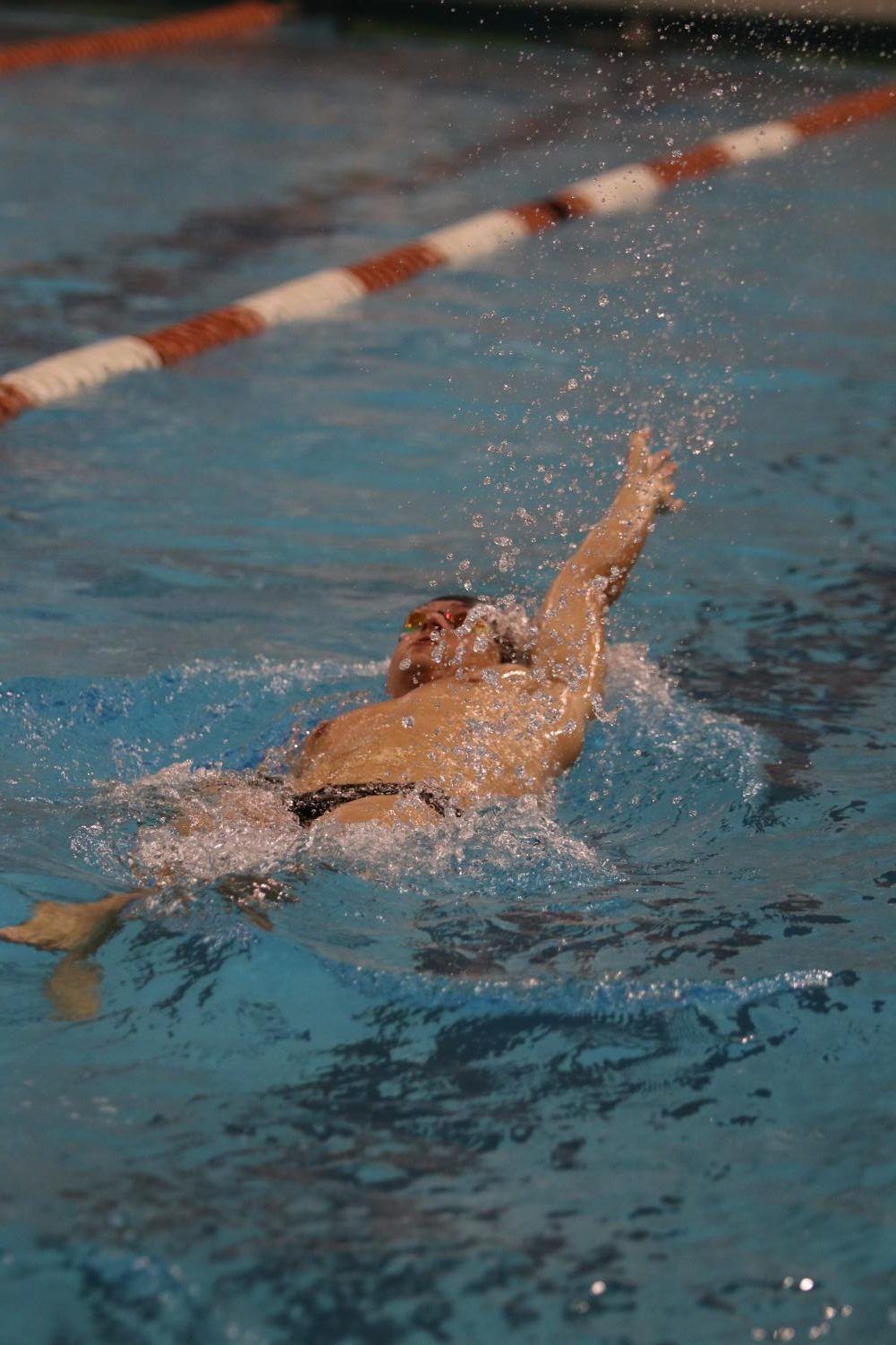 Jacob+Stubbs+%2718+begins+his+backstroke+during+his+relay.+