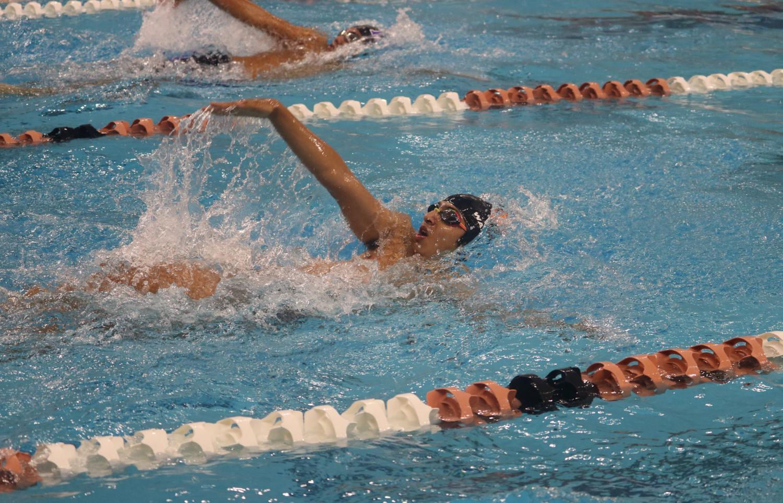 Atharva+Joshi+%2720+pulls+as+he+swims+backstroke.+