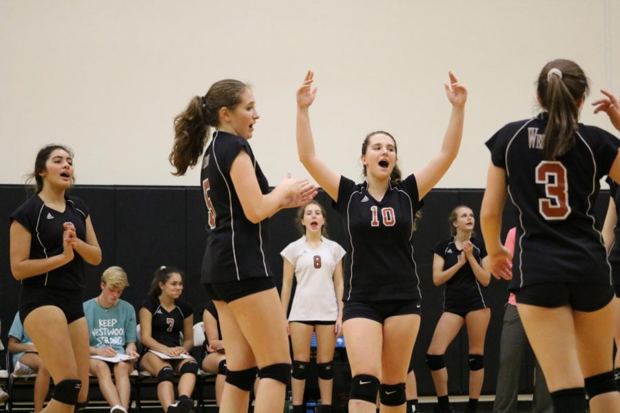 Lauren Kellly 21 throws her arms up in celebration of a point for Westwood.