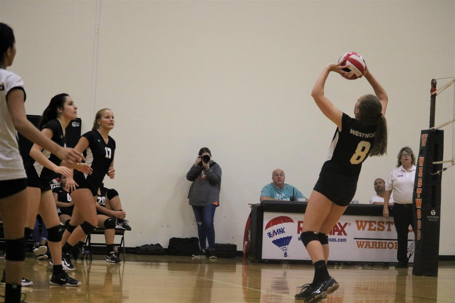 Colleen+Wyrick+%2721+sets+the+ball+back+for+her+teammates.+