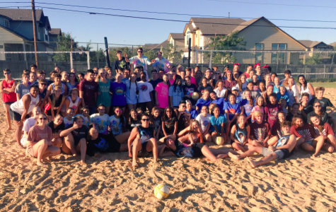 The participants of Spike Fest pose together on the sand courts. Photo credit to Westwood Volleyball.