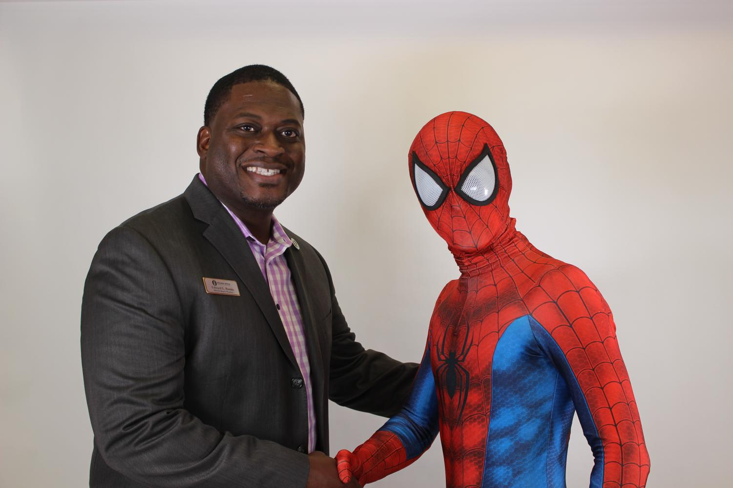 RRISD+Board+of+Trustees+member+Edward+Hanna+and+Spider-Man+exchange+a+handshake.