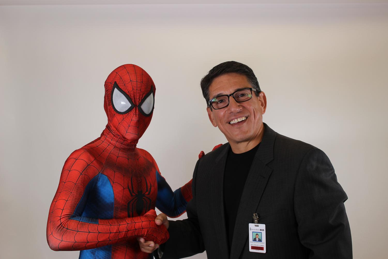 Dr.+Steve+Flores+shakes+hands+with+Spider-Man.