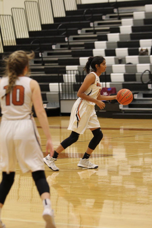 Anisha+Chintala+%2721+dribbled+the+basketball+toward+the+basket.