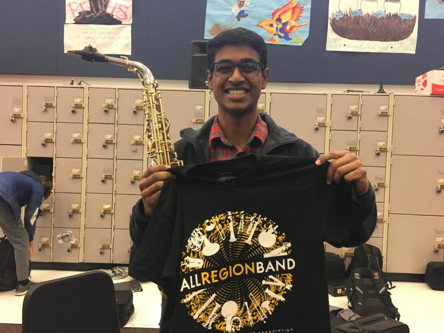 Ani+Sreeram+%E2%80%9819+holds+up+his+All+Region+Band+shirt.