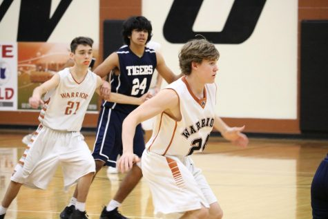 JV Boys' Basketball Upsets Tigers 55-45