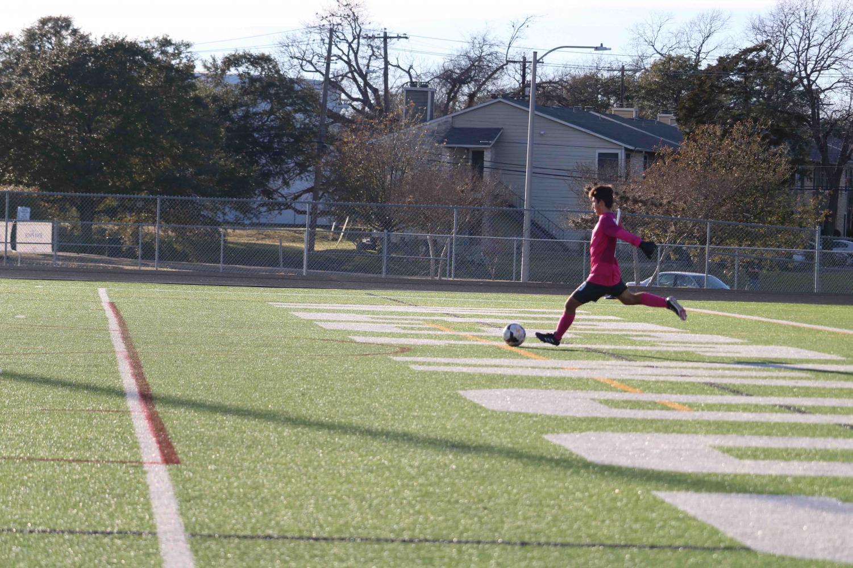 Emilio+Penny+%2720+kicks+the+ball+back+to+midfield.