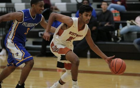 Karthik Shetty '19 dribbles the ball past a Pflugerville defender.